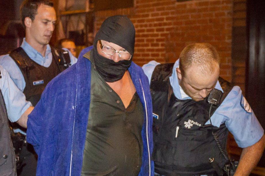 Richard Henry Bain lors de son arrestation.... (Photo Olivier Pontbriand, La Presse)