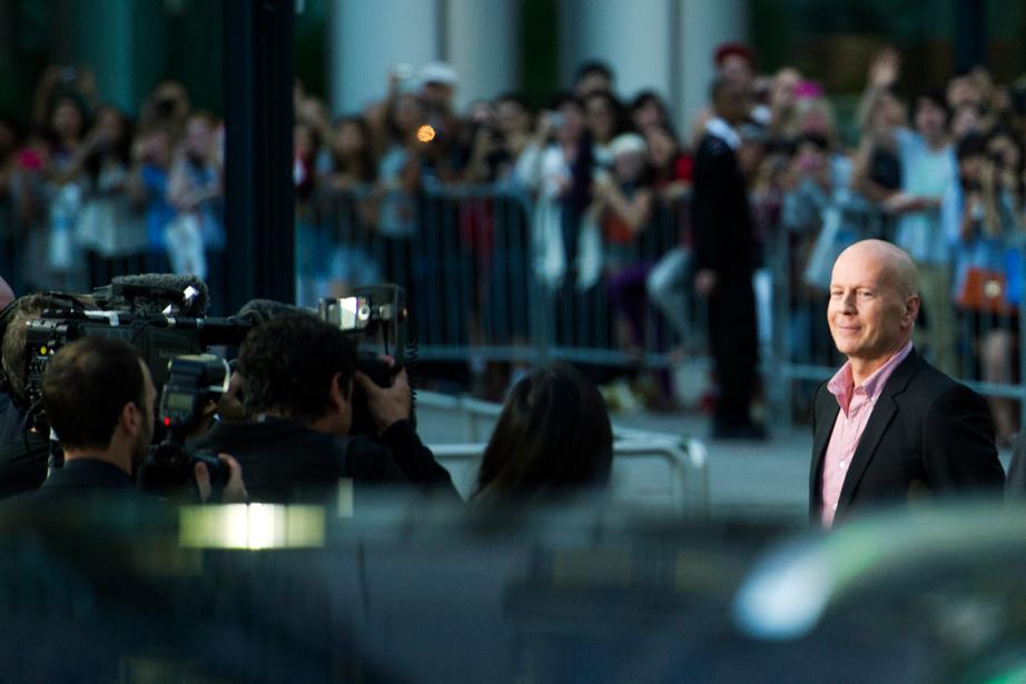 Bruce Willis sur le tapis rouge de Looper,... (PHOTO NATHAN DENETTE, LA PRESSE CANADIENNE)