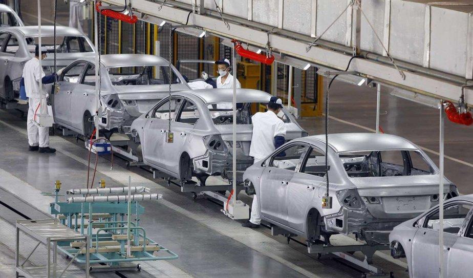 Une usine de montage de Honda en Chine... (PHOTO AP)