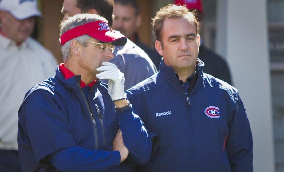 L'ancien président du Canadien, Pierre Boivin, discute avec son successeur Geoff Molson. | 19 septembre 2012