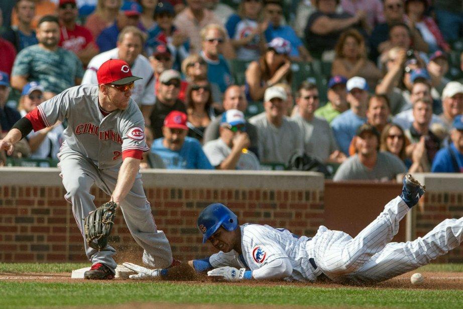 Todd Frazier des Reds et Starlin Castro des... (Photo Charles Cherney, Associated Press)