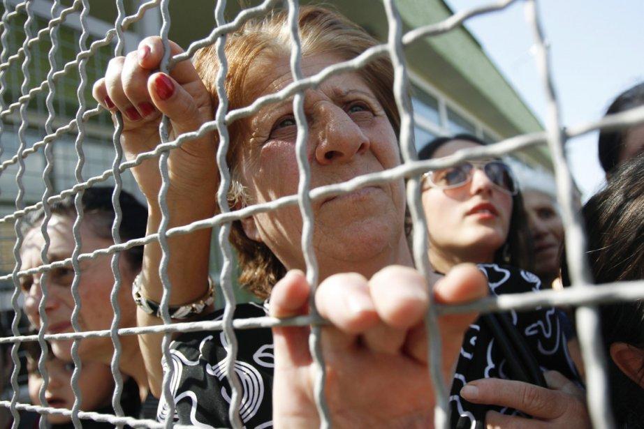 Des proches de prisonniers participent à une manifestation... (PHOTO DAVID MDZINARISHVILI, REUTERS)