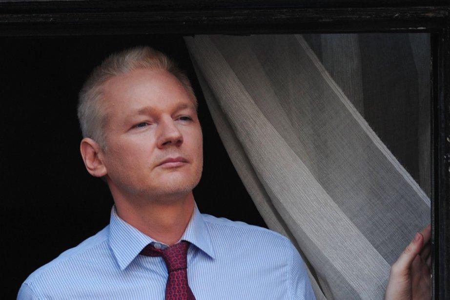 Julian Assange... (PHOTO CARL COURT, AFP)