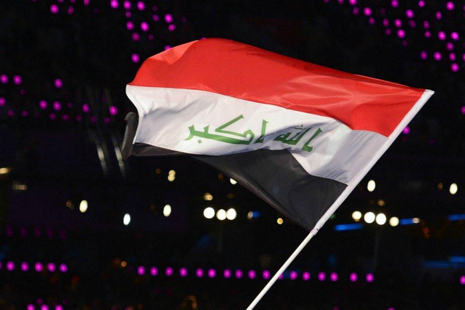 Depuis 2008, l'étendard irakien consiste en trois barres... (Photo Leon Neal, Agence France-Presse)