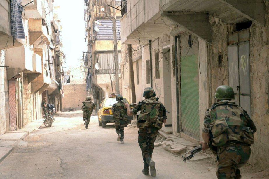 Au moins 18 soldats syriens auraient péri dans... (PHOTO AFP)