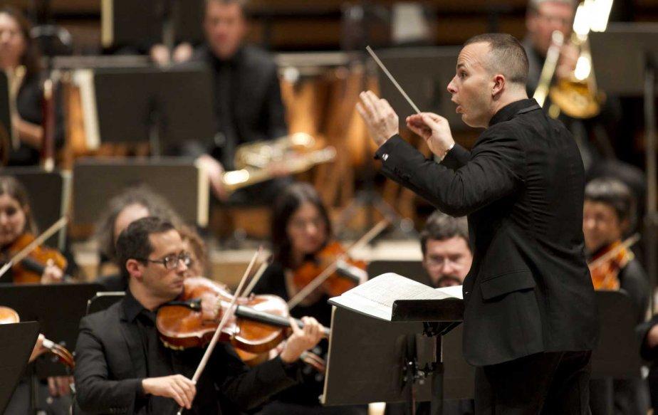 Un musicien de l'Orchestre Métropolitain et le chef,... (PHOTO HUGO-SÉBASTIEN AUBERT, LA PRESSE)
