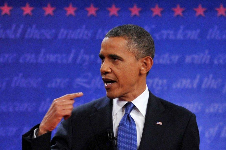 Le président Obama répond à Mitt Romneu lors... (Photo Nicholas Kamm, AFP)
