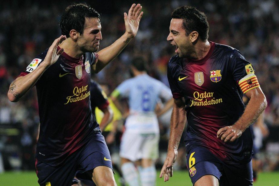Deux vedettes du FC Barcelone d'origine catalane, Cesc... (Photo : Josep Lago, AFP)