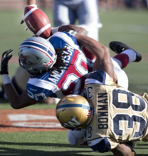 Marcellus Bowman de Winnipeg  et Victor Anderson des Alouettes. | 8 octobre 2012