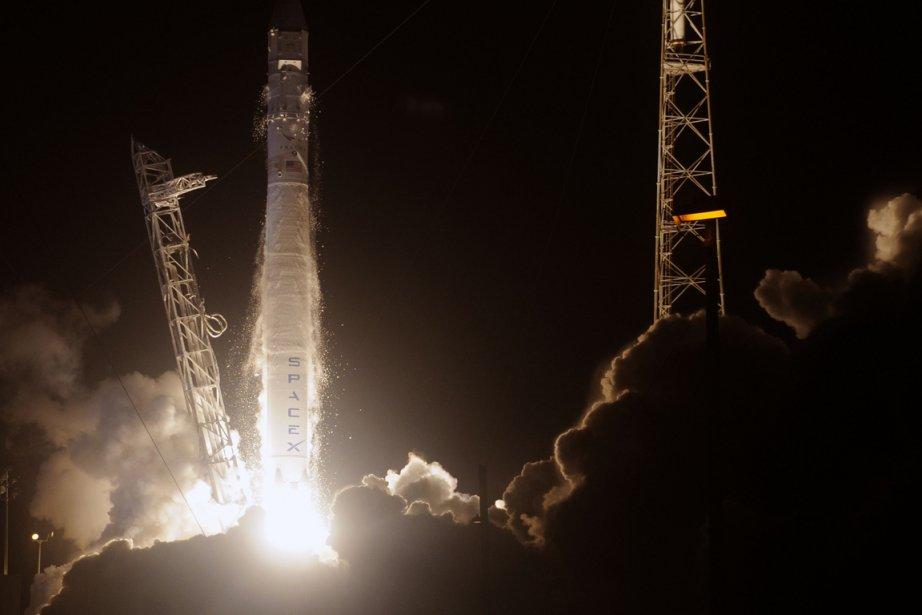 L'un des neuf moteurs du lanceur Falcon 9... (Photo AFP)