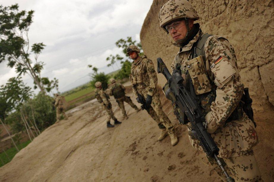 Cinq cents soldats de l'actuel contingent de 4... (Photo : Kai Pfaffenbach, Reuters)
