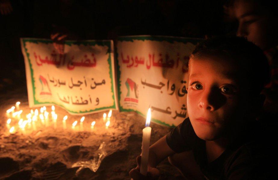 599751-bande-gaza-enfant-palestinien-camp ENFANTS ET GUERRE