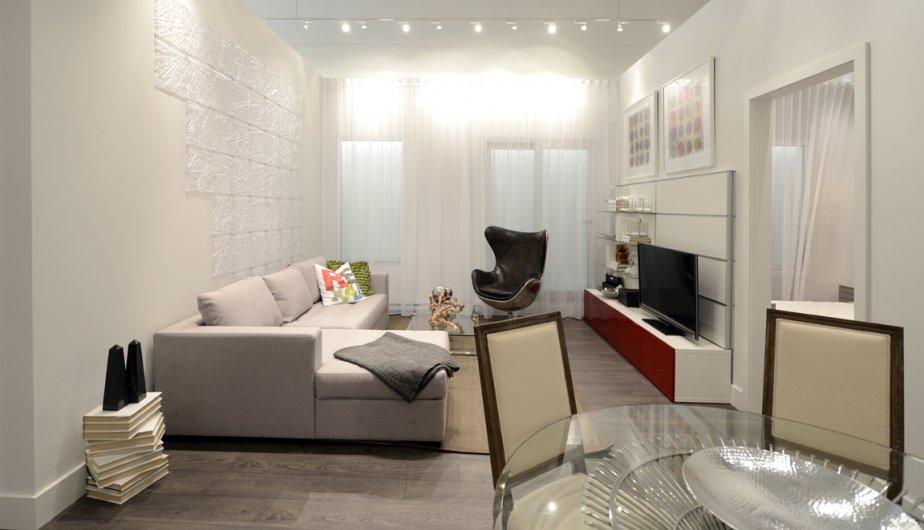 L'appartement-témoin, d'une superficie de 843 pieds carrés, comprend deux chambres et deux salles de bains. Ce condo, surnommé «lumière», se vend entre 400 000$ et 475 000$ (taxes en sus). | 15 octobre 2012