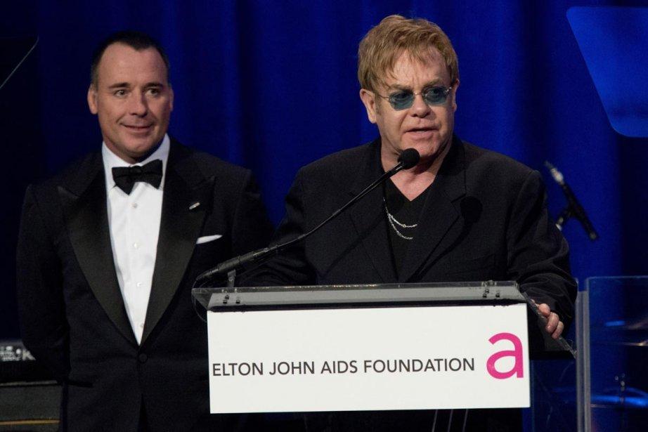 David Furnish et Elton John au gala annuel... (Photo: AP)