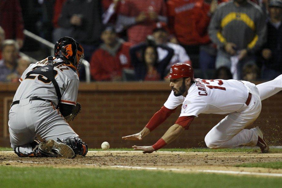 Matt Carpenter (à droite), des Cardinals, a profité... (Photo: Reuters)