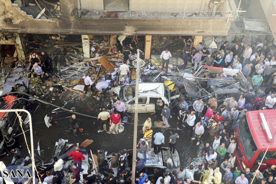 «Un attentat terroriste à la voiture piégée près... (PHOTO REUTERS/SANA)