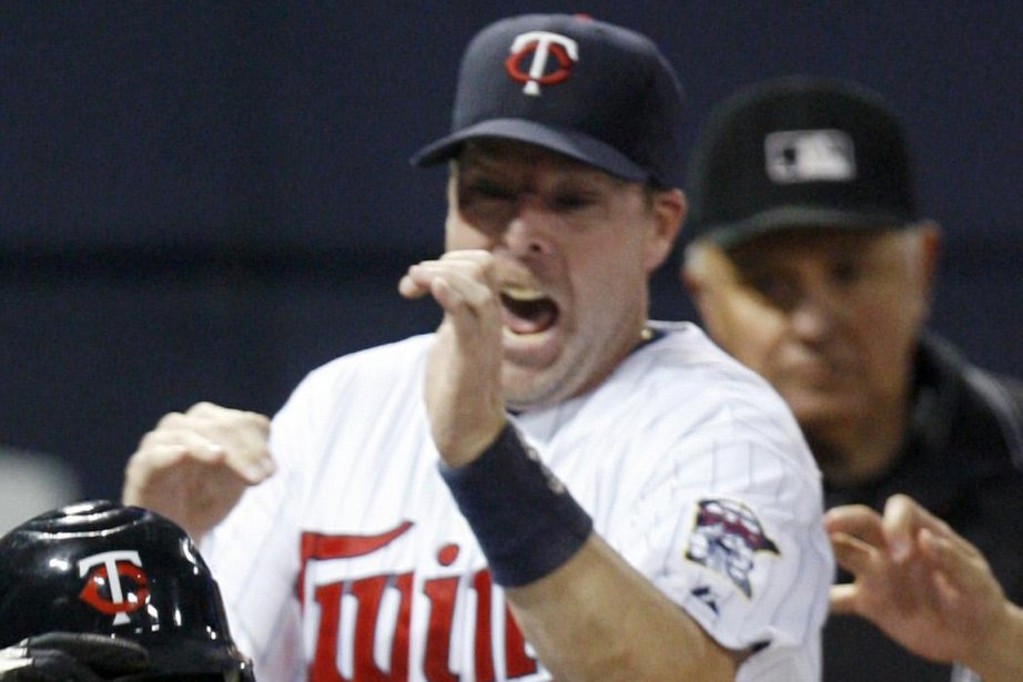 Mike Redmond dans l'uniforme des Twins du Minnesota,... (Photo: archives Reuters)