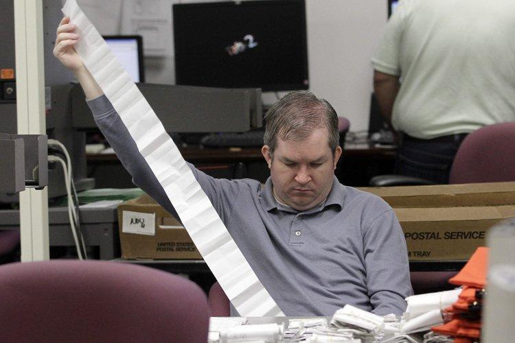 Le bureau des élections n'exclut pas que l'attente... (Photo: AP)