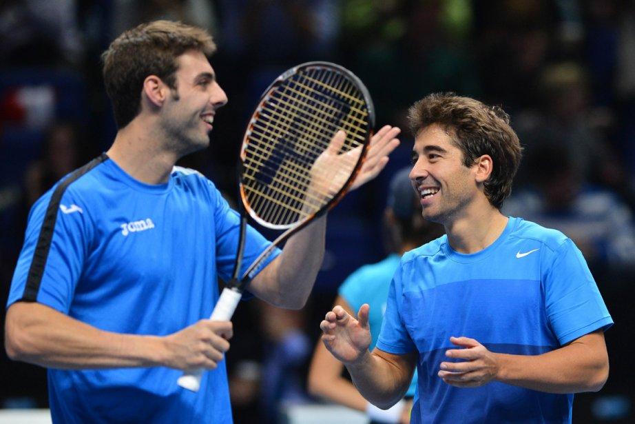 Marcel Granollers et Marc Lopez... (Photo : Ben Stansall, AFP)
