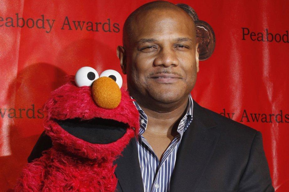 Kevin Clash et sa marionnette Elmo.... (Photo: AP)