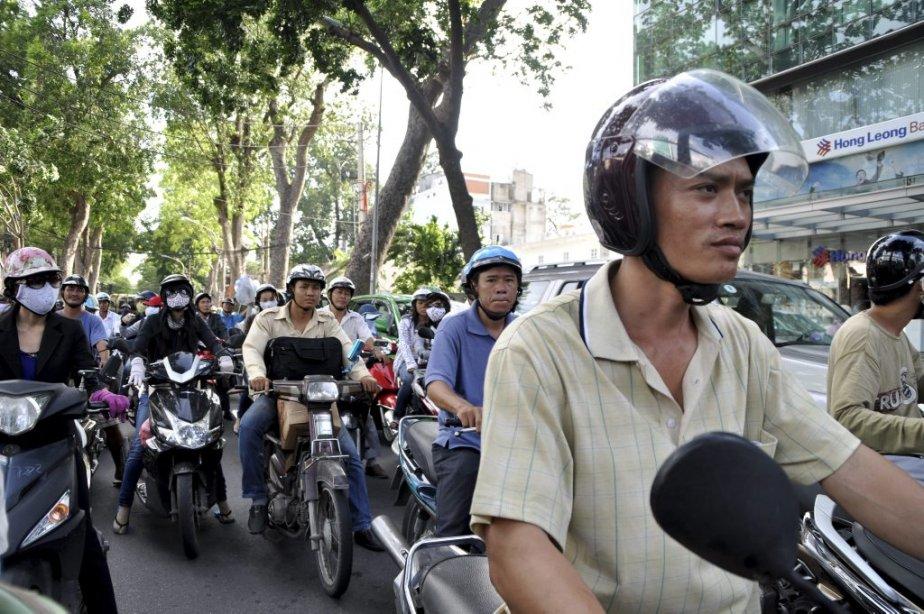 Des millions de mobylettes foulent les rues d'Hô... (Photo: Julie Ménard, collaboration spéciale.)