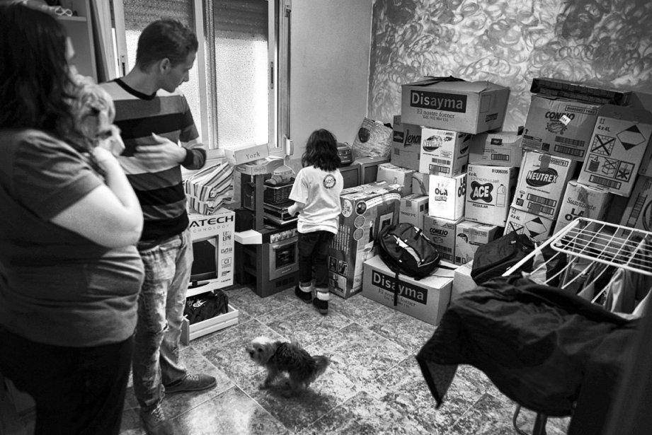 Maria del Mar Rodriguez, son mari, Jonathan Martin, et leur fille Paula se préparent à être expulsés. | 5 décembre 2012