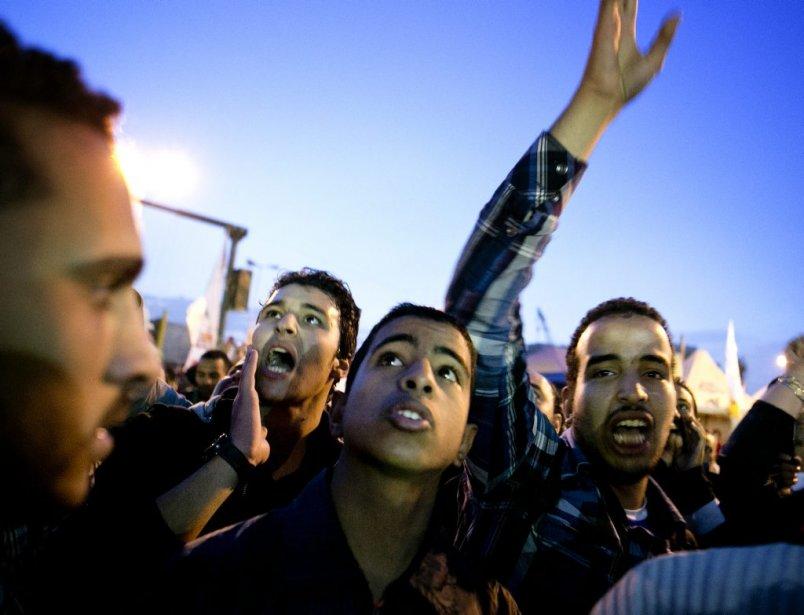 Des manifestants sont réunis sur la place Tahir, haut lieu du Printemps égyptien qui a mené à la chute du raïs Hosni Moubarak, le 9 décembre. | 10 décembre 2012