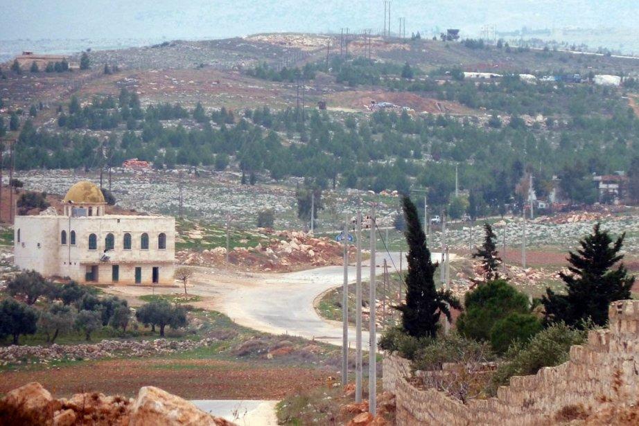 Le Front Al-Nosra, la brigade al-Mouhajirine et le... (PHOTO HERVE BAR, AFP)