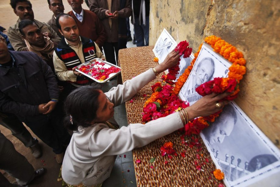 Teachers and staff pay tribute to legendary Indian sitar player Ravi Shankar at the Bengali Tola Inter College where Shankar had studied in Varanasi, India, Wednesday, Dec. 12, 2012. Shankar, who is credited with connecting the world to Indian music, died Tuesday in San Diego at the age of 92.... (Rajesh Kumar Singh)