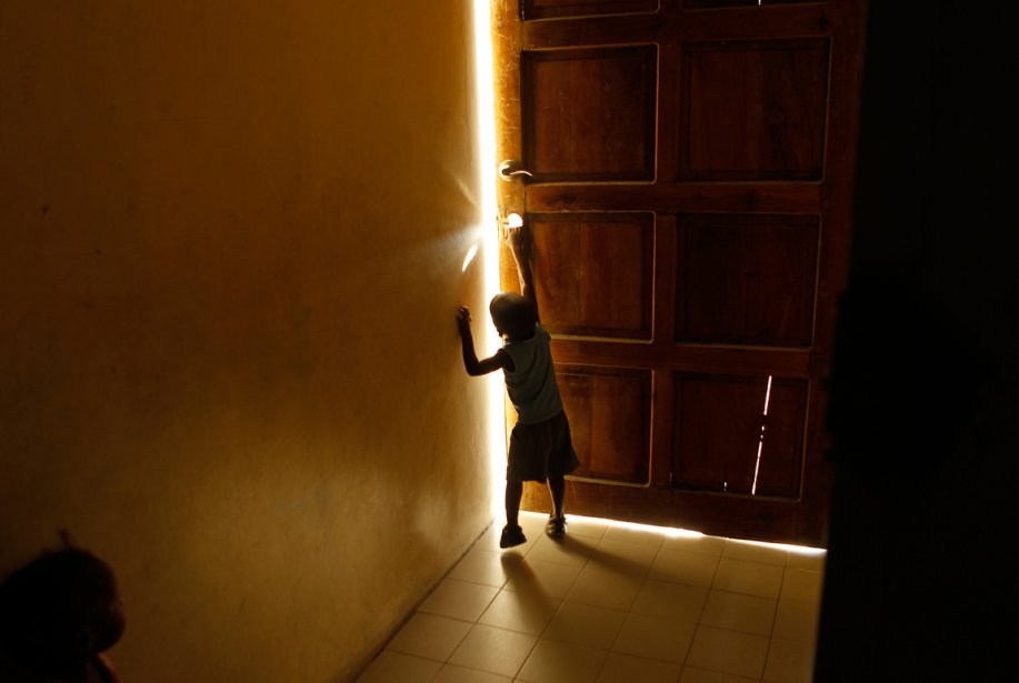 Les 100 photos de 2012 7 milliards d 39 humains for Porte qui s ouvre lumiere
