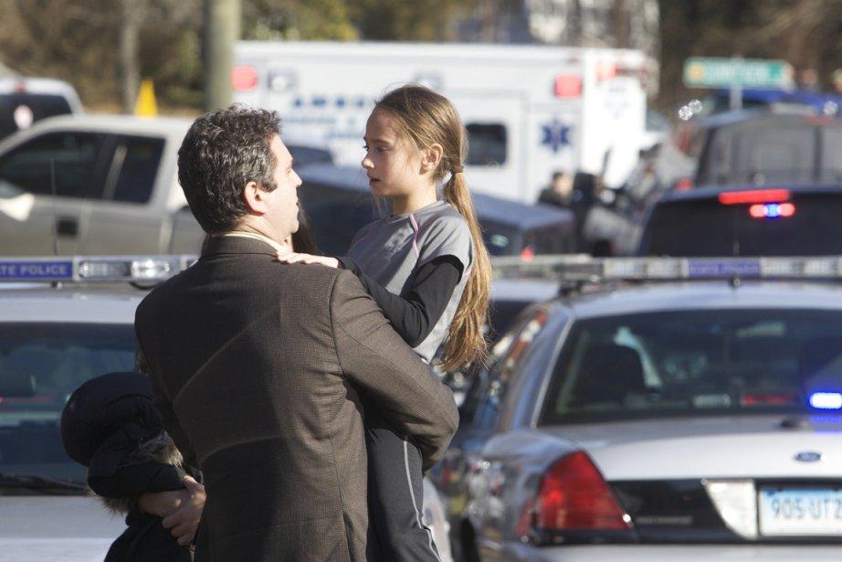 Des parents sont rapidement arrivés sur les lieux... (Photo : Michelle McLoughlin, Reuters)
