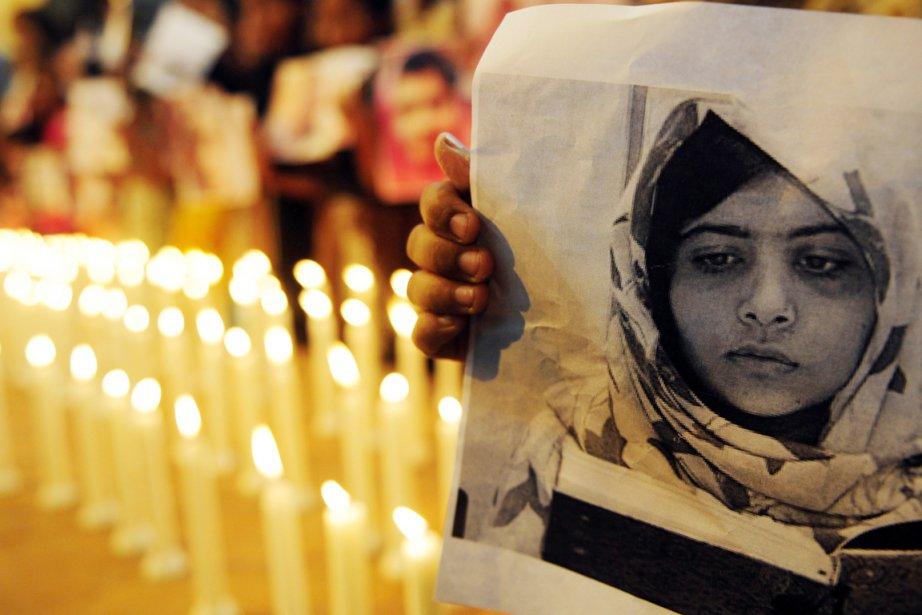 Des partisans de la jeune militante pakistanaiseMalala Yousafzai... (PHOTO RIZWAN TABASSUM, ARCHIVES AFP)