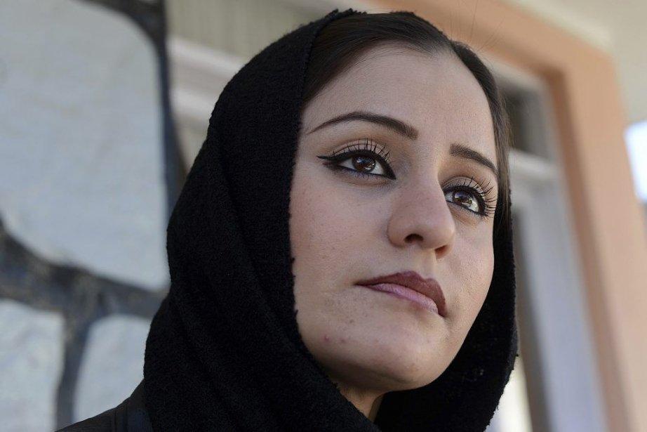 Soosan Feroz... (Photo: SHAH MARAI, AFP)