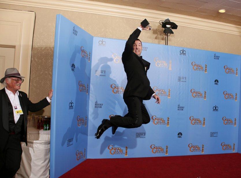 Le réalisateur Mark Andrews manifeste sa joie dans les coulisses après avoir obtenu le prix du meilleur film d'animation pour «Brave», aux 70e Golden Globe Awards à Beverly Hills, en Californie. | 14 janvier 2013