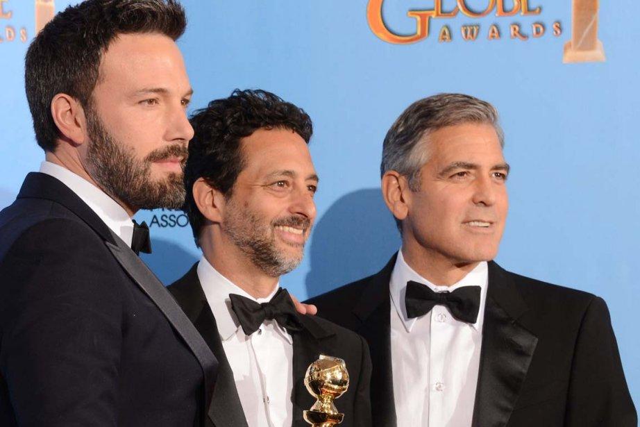 Le réalisateur et acteur principal de «Argo» Ben Affleck en compagnie des producteurs du film Grant Heslov and George Clooney. | 14 janvier 2013
