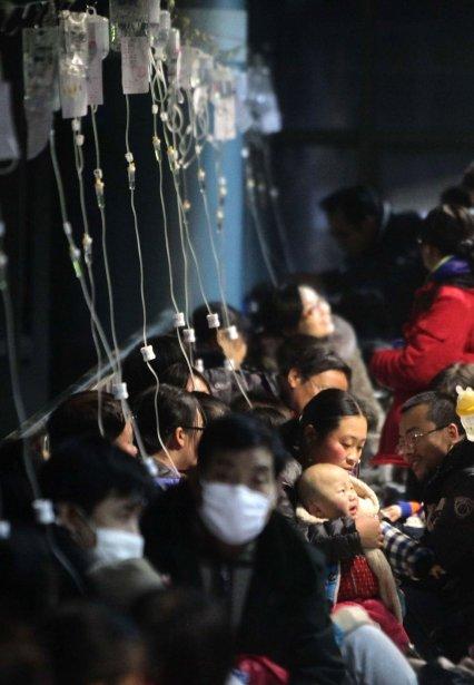 Des solutés à la disposition de ces patients souffrant de la grippe d'un hôpital de Pékin | 14 janvier 2013