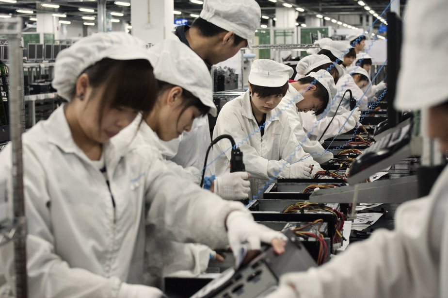 Des ouvriers du complexe industriel Quanta à Chongqing. | 17 janvier 2013