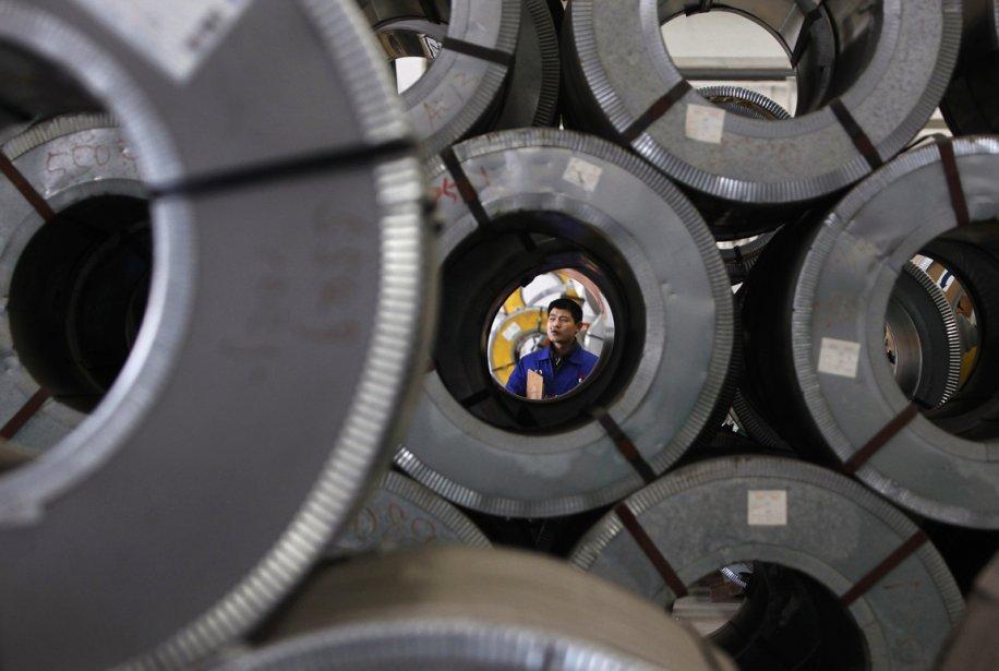 Un travailleur d'une usine métallurgique de Wuxi, en Chine. | 29 janvier 2013