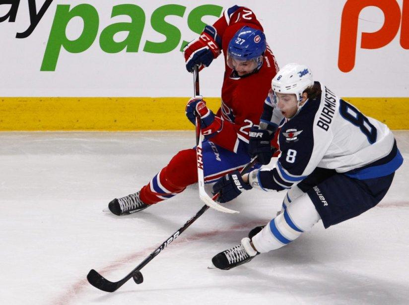 Alex Galchenyuk et Alex Burmistrov se battent pour la rondelle lors de la première période. (Photo Olivier Jean, La Presse)