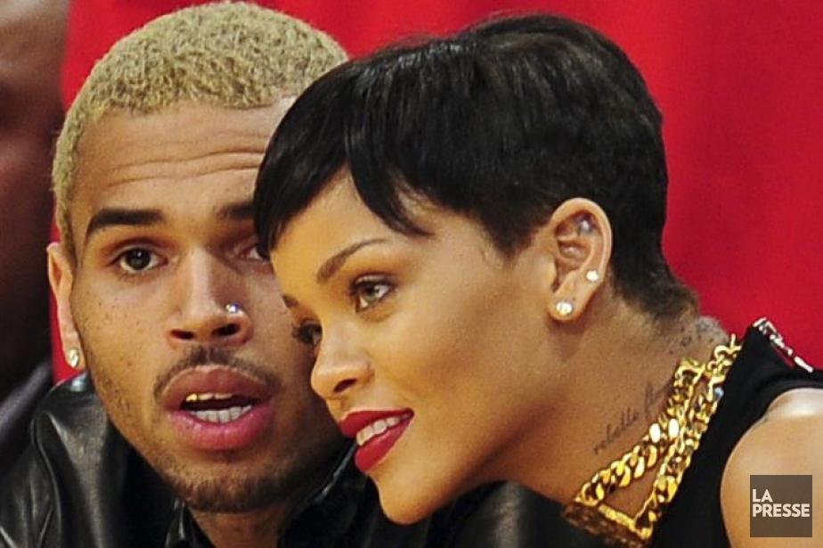 Chris Brown et Rihanna lors d'un match de... (Photo: AFP)