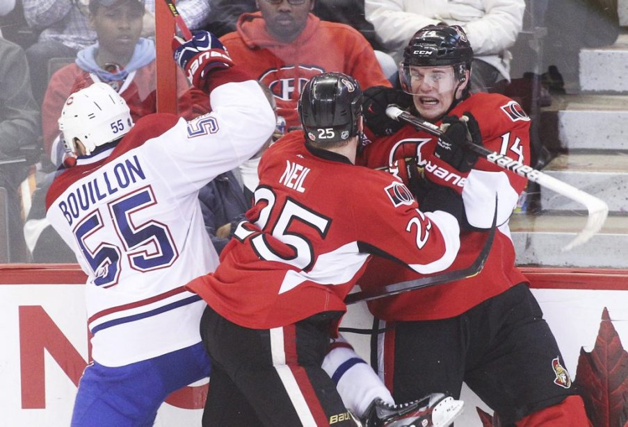 Francis Bouillon, Chris Neil et Colin Greening. (Patrick Woodbury, Le Droit)
