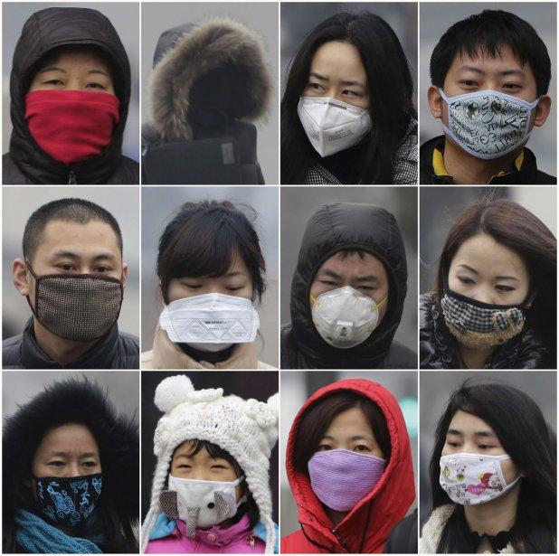 Des résidants de Beijing portent des masques pour affronter la pollution atmosphérique qui étouffe la mégalopole chinoise. | 31 janvier 2013