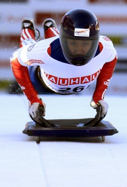 Elizabeth Yarnold de la Grande Bretagne s'élance sur la piste de glace naturelle lors des Championnats du monde de la FIBT 2013 à Saint-Moritz, en Suisse. | 31 janvier 2013
