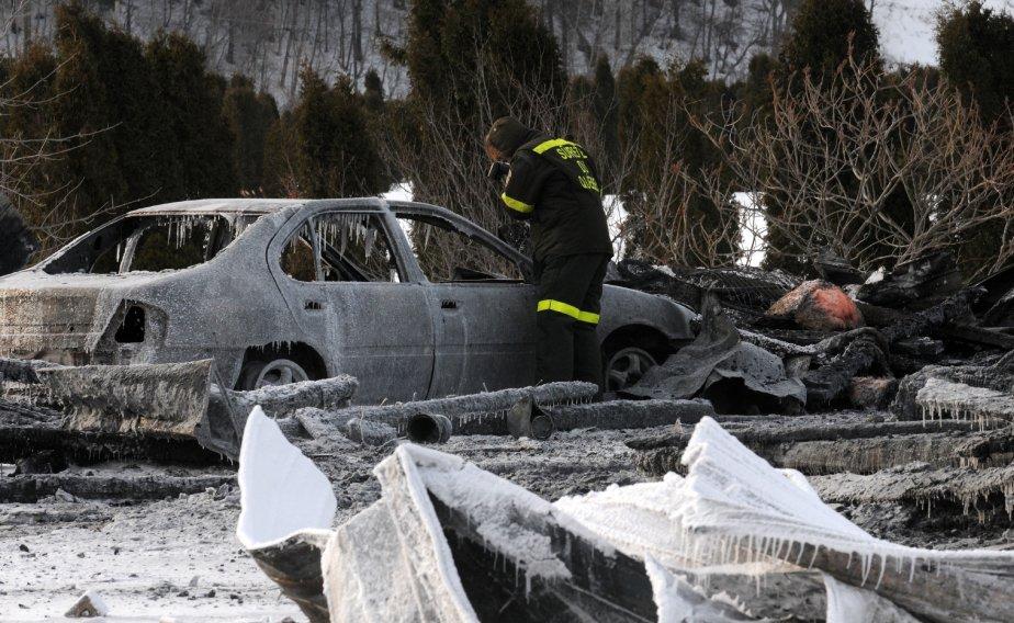 La voiture des victimes se trouvait tout près de la maison. | 1 février 2013