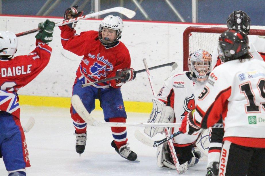 Match opposant les Éclaireurs à l'Avalanche dans la catégorie AA au Tournoi pee-wee de Waterloo. | 8 février 2013