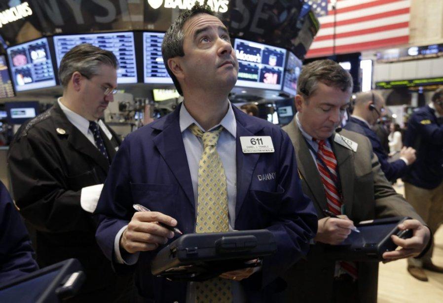 Un courtier sur le plancher de la Bourse... (PHOTO d'archives RICHARD DREW, Associated Press)