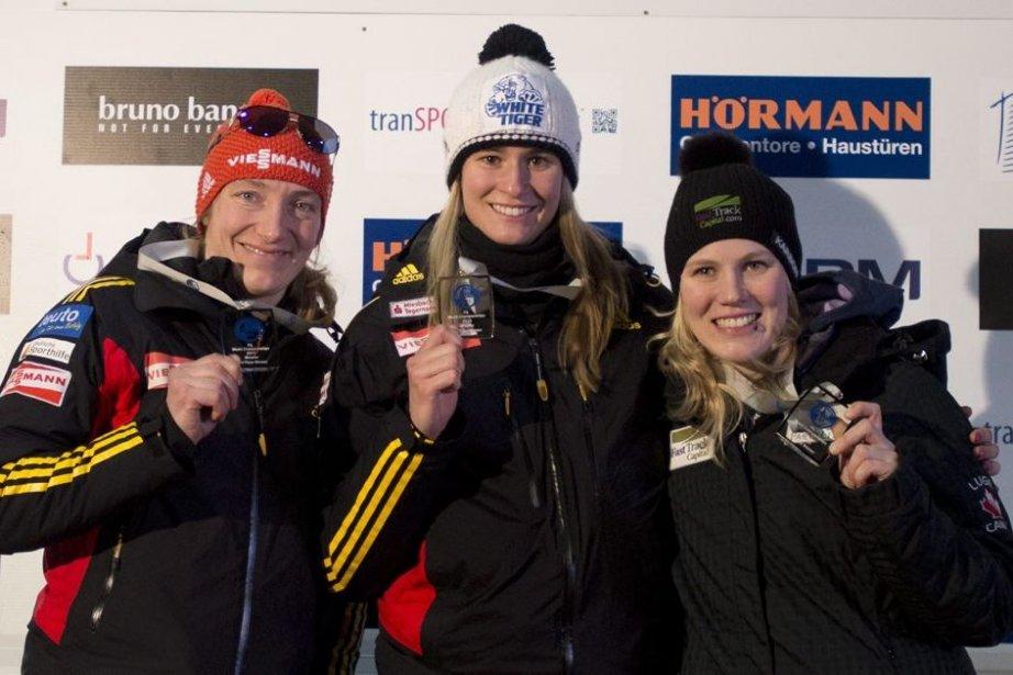 Natalie Geisenberger, au centre, Tatjana Hufner, à gauche,... (Photo Jonathan Hayward, La Presse Canadienne)