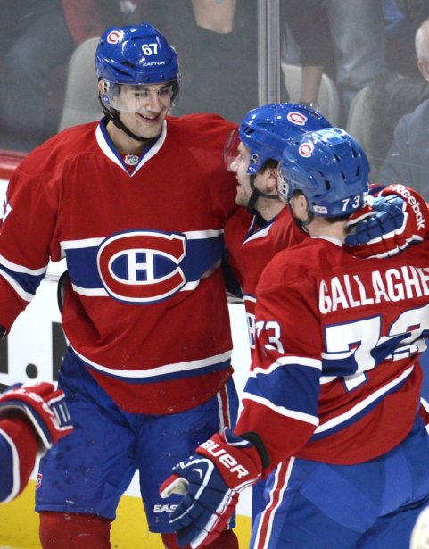David Desharnais célèbre son but entouré de Max Pacioretty et Brendan Gallagher. | 16 février 2013