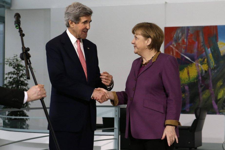 John Kerry etAngela Merkel...