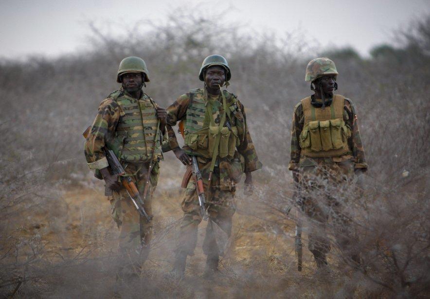 Des  soldats ougandais en mission en Somalie avec l'Union africaine se préparent à une avancée sur la ville de Buur Hakaba. | 28 février 2013